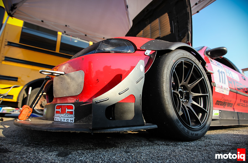 Upshot of front corner of Civic with canards, overfender, splitter, wheel and tire