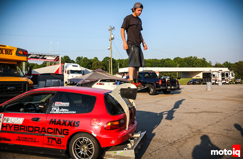 Thruxton standing on top of his wing on his car