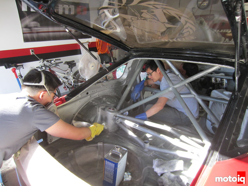 Joe Lu and Josh Wang prep the car for paint - this time with marine paint