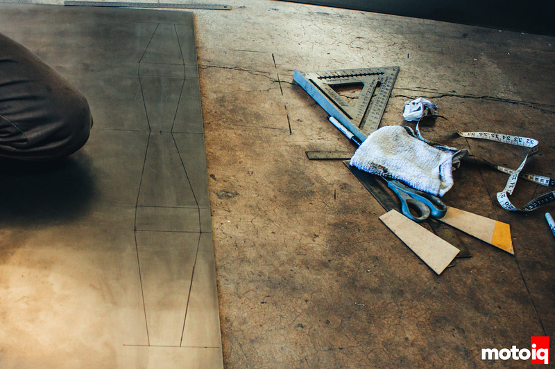 Racecars seem suspiciously built out of lots of rulers. Rocco uses stencils to create what will become a gusset.