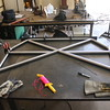 The center line of the hoop is marked on the table, and the lines that the cross bars and harness bar will follow are marked on the table. This allows for accurate fitment.  Each tube has a center line drawn on it that allows me to check straightness of the split tubes during the process.