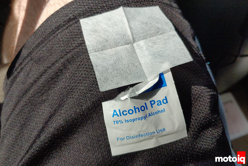 an alcohol pad opened and unfolded on my leg