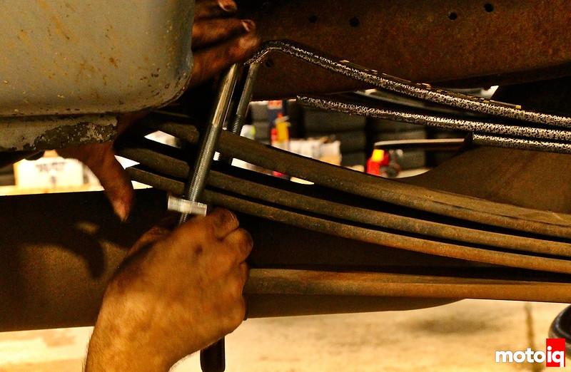 hand bolting a u-bracket tying the helper spring stack to the main spring stack