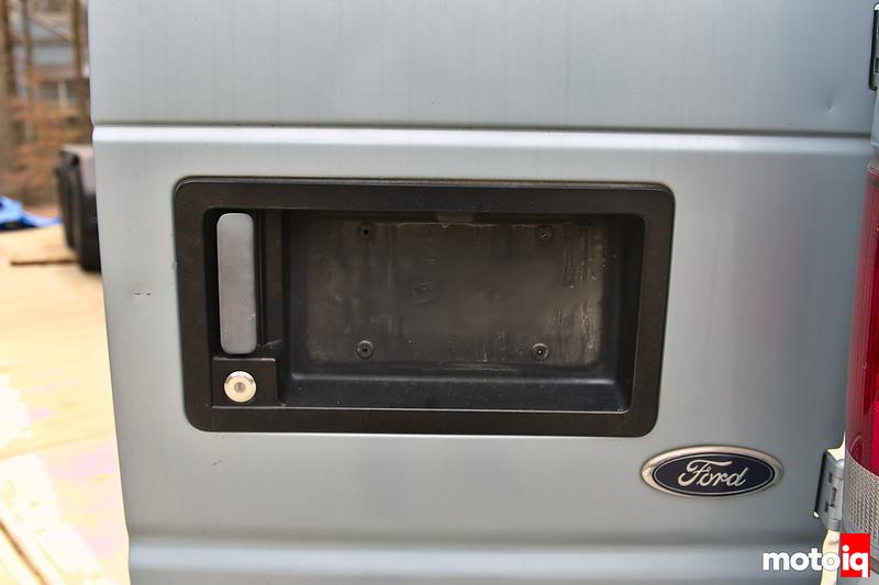 rear passenger van door with license plate removed