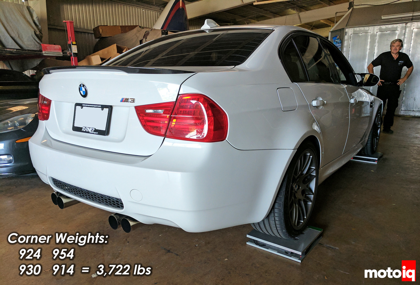 E90 M3 on scales corner weight