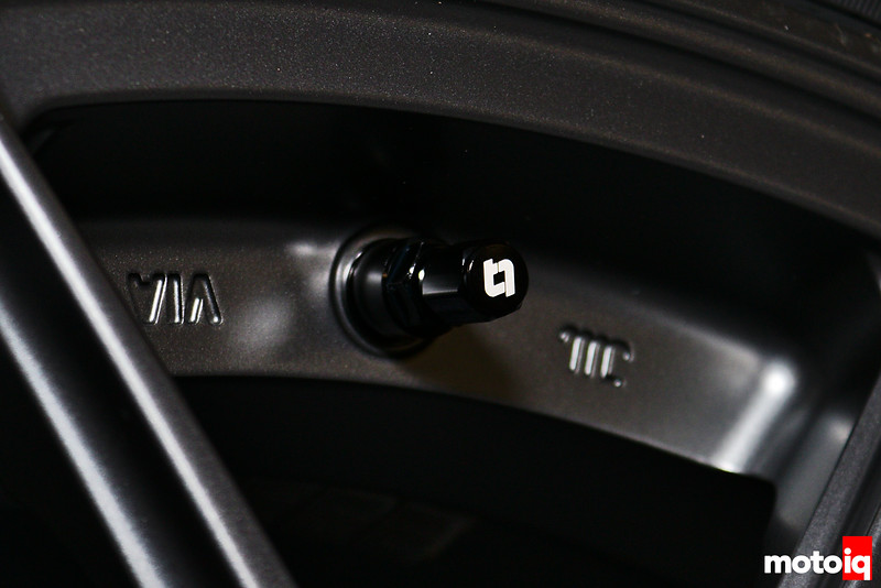 Titan 7 logo on valve stem cap which is on valve stem on wheel