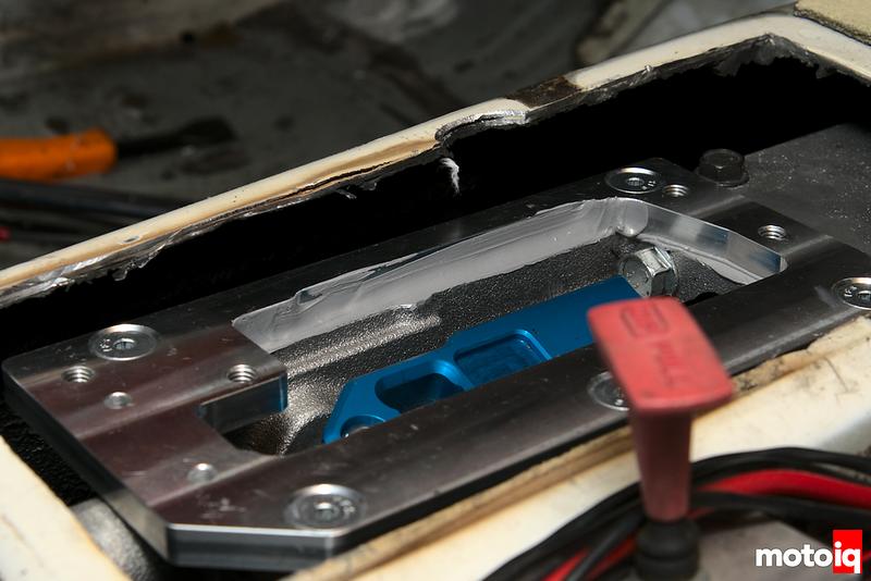 liquid gasket spread around inner wall of adapter plate