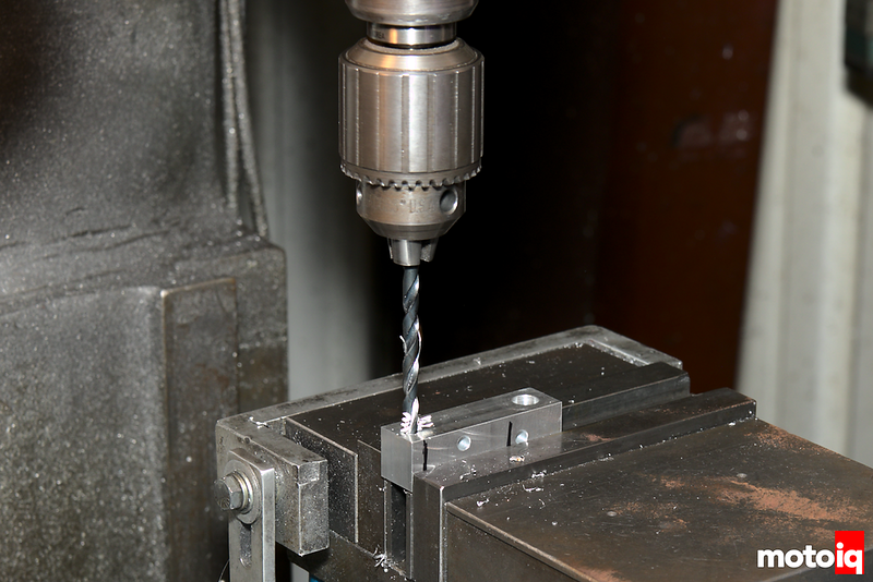 drill bit making a hole in the machined block