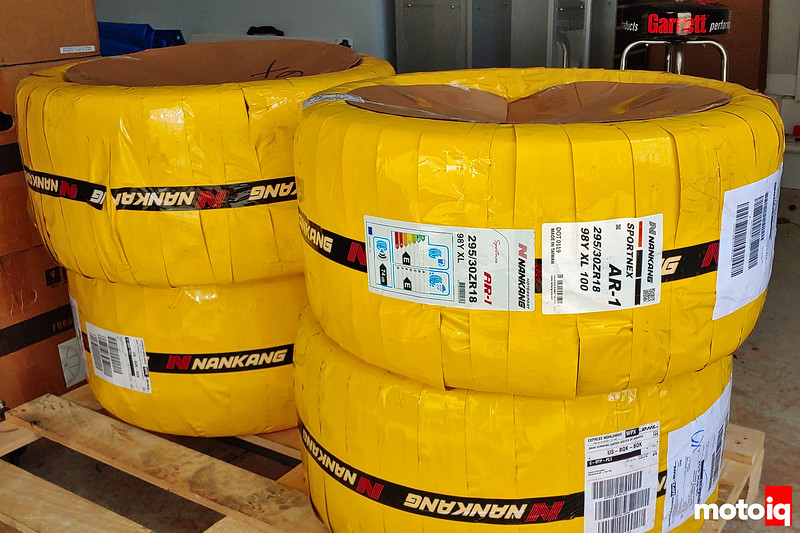 Yellow shrinkwrapped Nankang Sportinex AR-1 tires in a pile