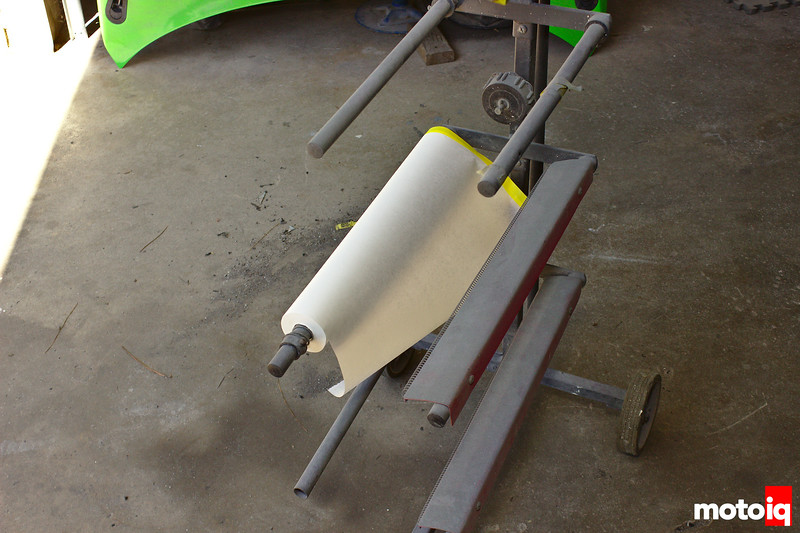 a role of masking paper pre-taped on one end on a stand