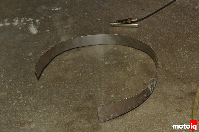 stenciled strip of metal laying on ground