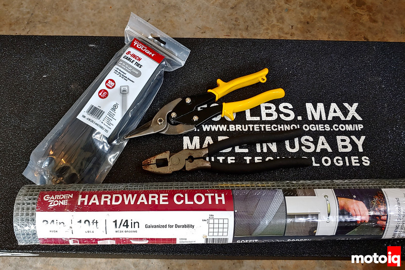 bag of zip ties, tube of hardware cloth, sheet metal shears, and beefy side cutter
