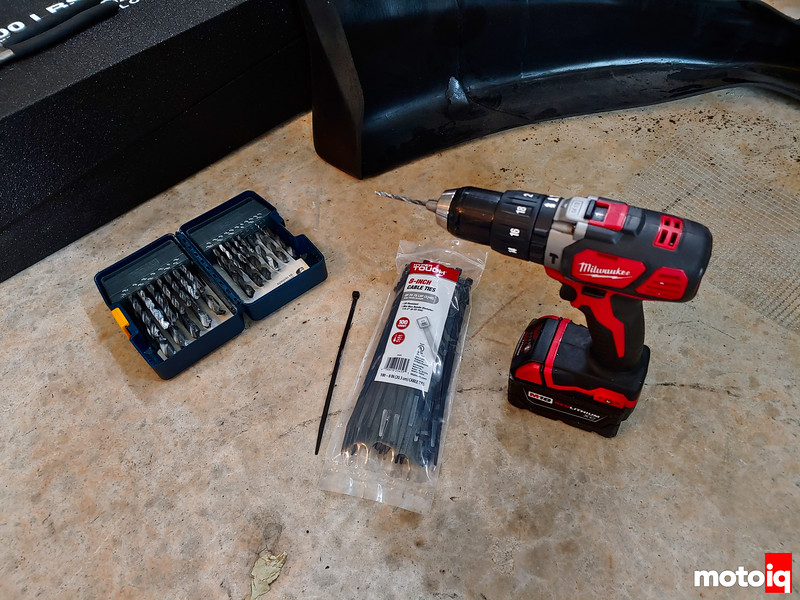 drill, drill bits, and zip ties sitting on floor