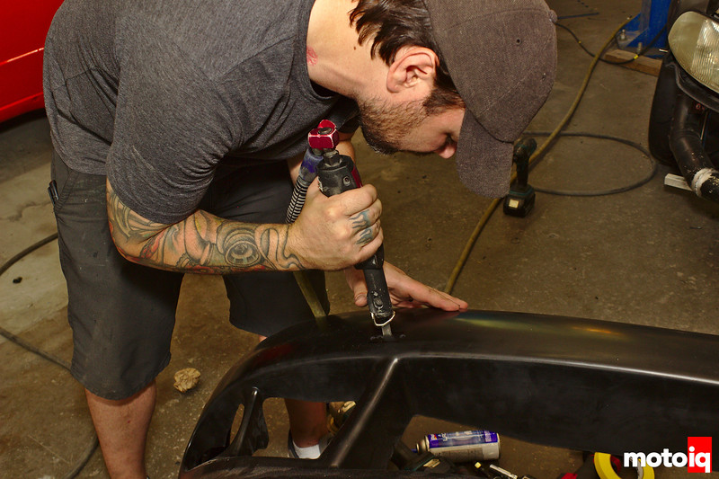 using an air saw to cut a slot in the front bumper