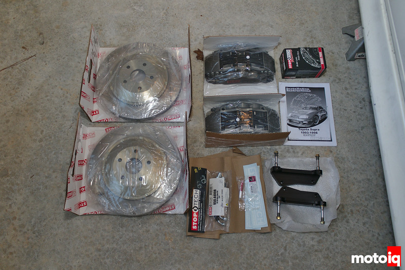 Unboxed front StopTech BBK with rotors, calipers, brackets, and accessories nicely shrinkwrapped