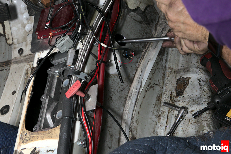 using a long extension on a ratchet through the new hole in the transmission tunnel