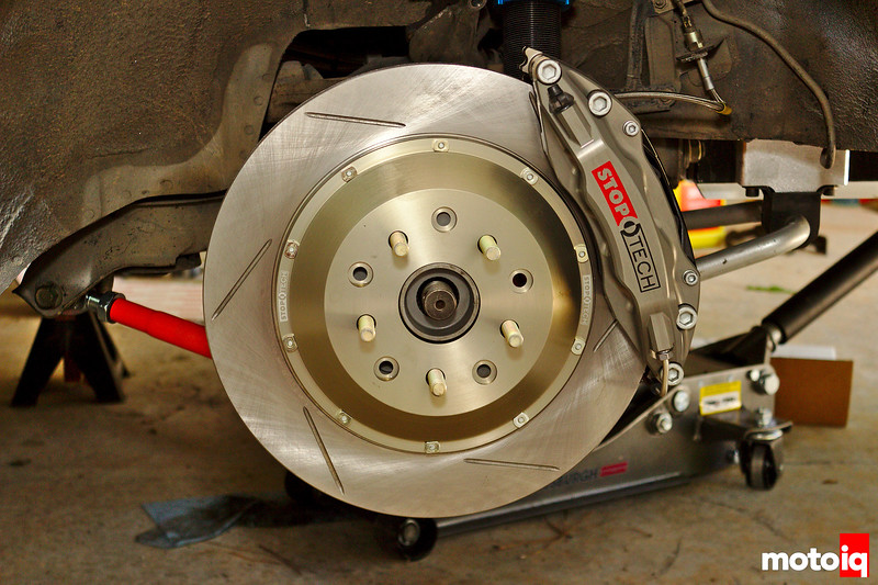 Straight on view of StopTech Trophy 4-piston caliper on brake rotor