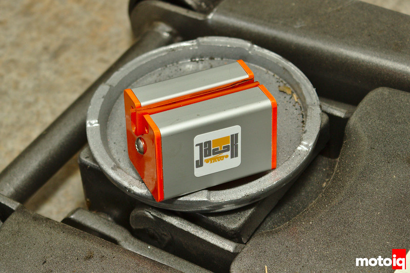 orange and silver aluminum block with u-channel and silicone