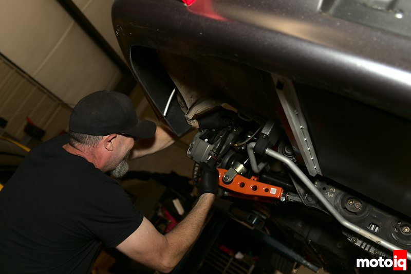 gut using a small impact wrench to remove a brake caliper