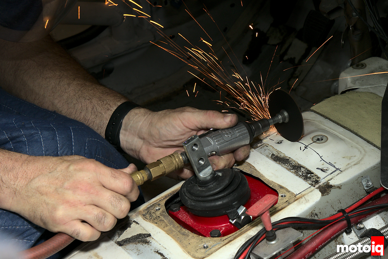 sparks flying off as cutting wheel slices transmission tunnel