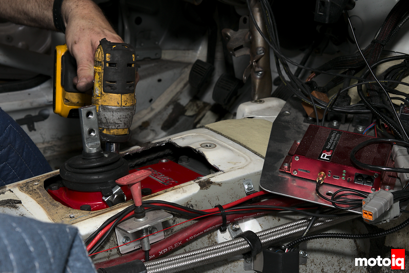 using small dewalt electric impact to unbolt tremec shifter assembly