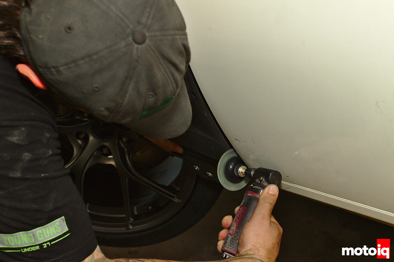 using air sanding wheel on edge of front fender in front of door