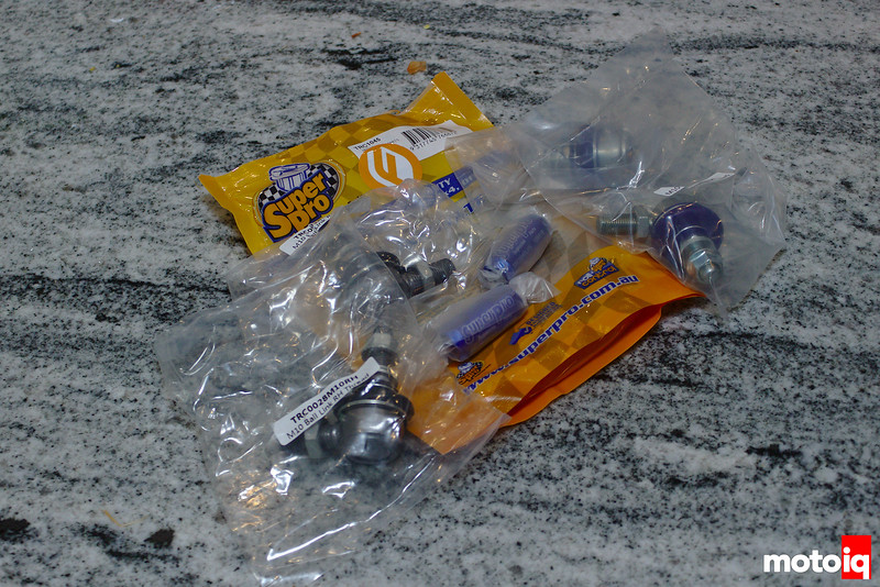 Plastic bags with endlink components laying on black and white speckled/striped granite countertop
