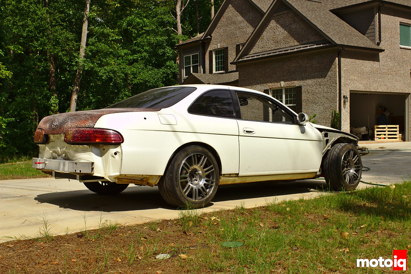 SC300 rear quarter view, car in driveway, missing bumpers, fenders, and side skirts