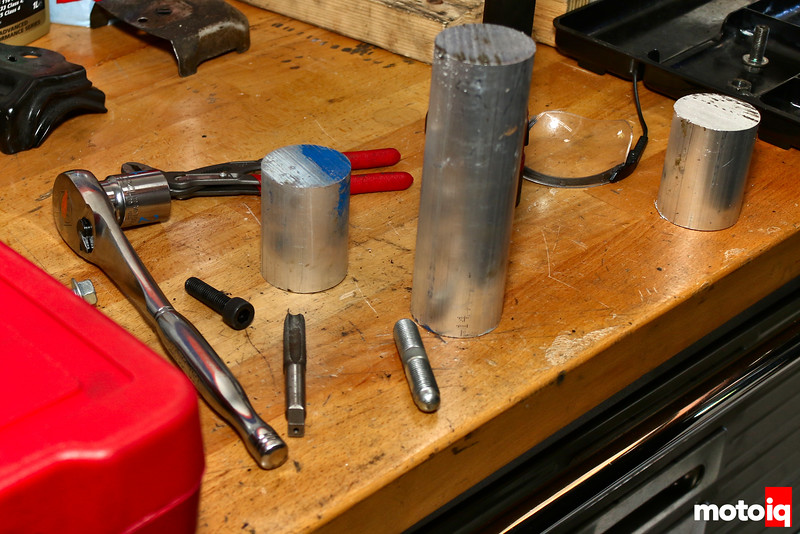 Various Height Billet Aluminum Cylinders on Workbench
