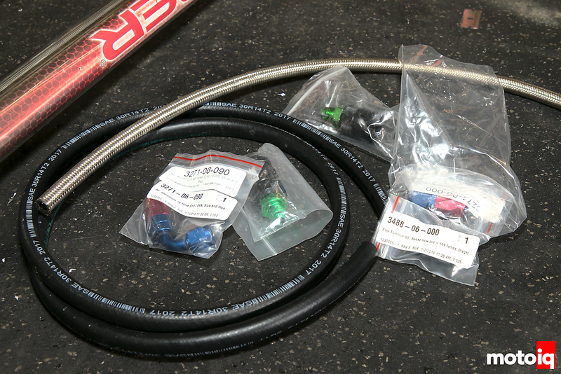 several baggies of AN fittings, braided and regular fuel hose