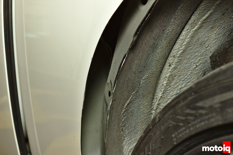view inside cut quarter panel showing unibody underneath