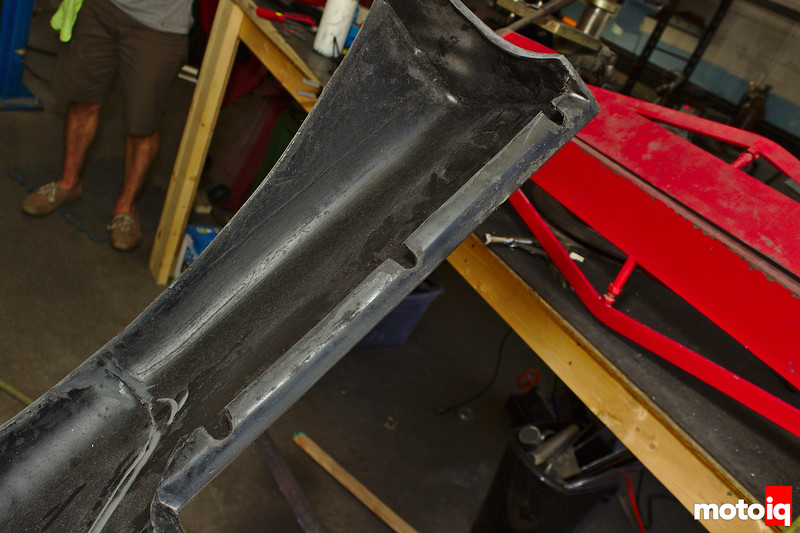 hole slots cut into rear bumper mounting surface