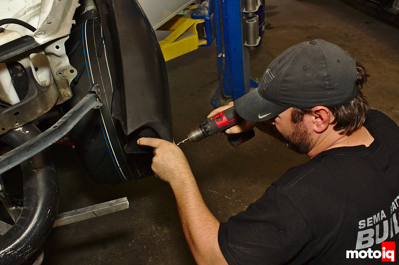 drilling a hole into the fender's mounting tab