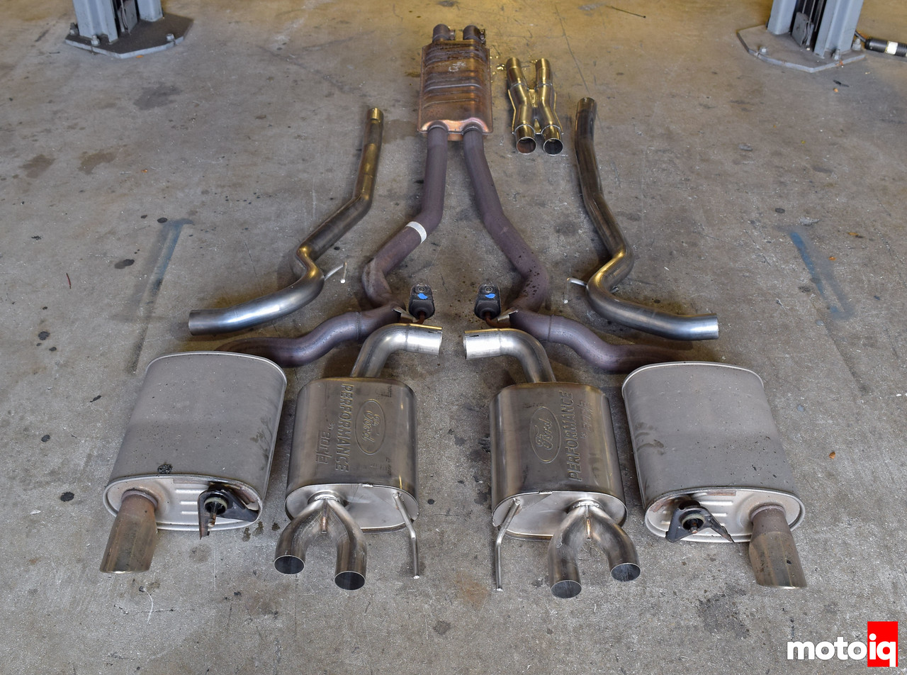 Stock 2015 Mustang GT exhaust next to Ford Performance by Borla Touring Muffler