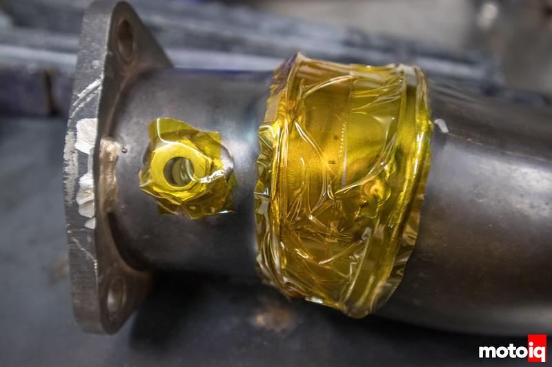 Kapton tape sealing exhaust pipe for back purging