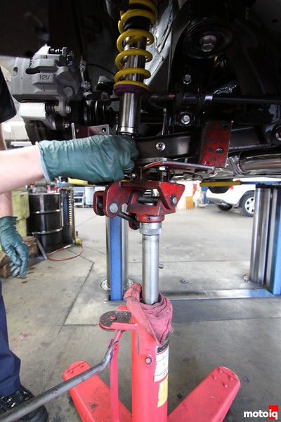 With the shock bodies being shorter with the KWs we use a tranny jack to lift up the  LCA to meet the attaching point. Home garage people will likely use a floor jack.