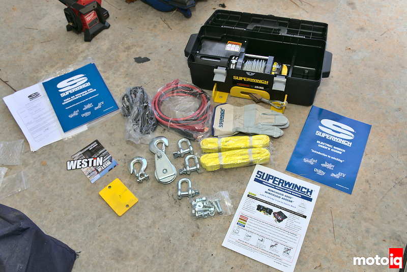 toolbox winch and accessories, manuals laid out on garage floor