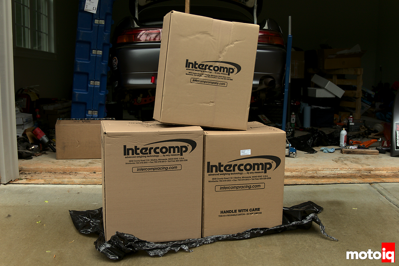Three Intercomp-labeled cardboard boxes in a pyramid.