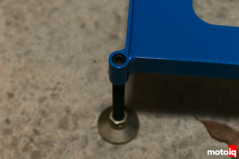 Close up of corner of scale pad looking at Allen key threaded foot adjuster.