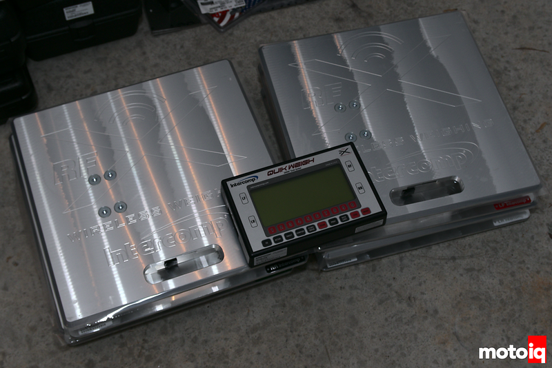 Shiny metal scales stacked two-by-two with the wireless display laying on top of them.