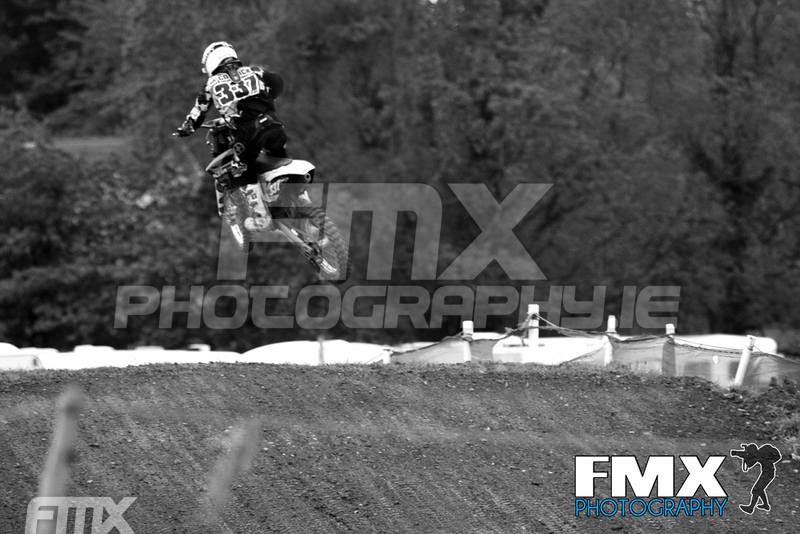 Glen McCormick pictured here over the ambulance jump on his way to win grade B in race 2. Only Took a handfull of photos from this angle and liked this one the best, chose black and white for a more neutral look.<br /> <br /> Taken with Canon 7d - 100-400 f4.5/5.6 - @ 320mm 1/800 in TV mode