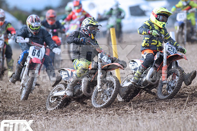 Rhys Hawthorne #26 gets the holeshot in the 85 race of Tom Garry #44.