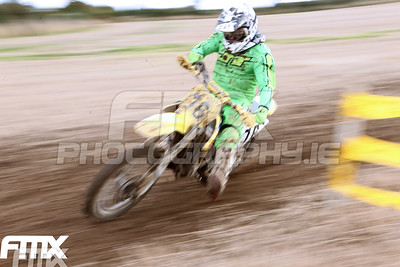 Shane McNally pans by in the second CMX2 race.