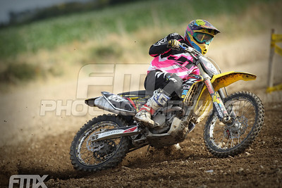Patrick Dunne gets loose out of bottom corner in the grade C race.