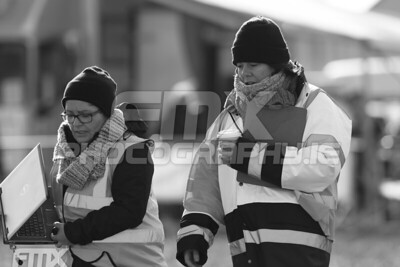 The lap scorers made sure they would stay as warm as they could.