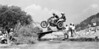 John Palfreyman and Thom Lund cross the infamous water hazard at the 1977 Viewfinder's Grand Prix at Indian Dunes Motorcycle Park, Valencia, California.