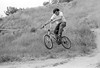 Butch Baum motocrossing his custom built Franko Frame Schwinn racer in a secret track in Woodland Hills.