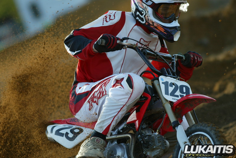 Joey Gluck up close and personal on his pit bike. Those bikes throw a lot of roost with that little tire.