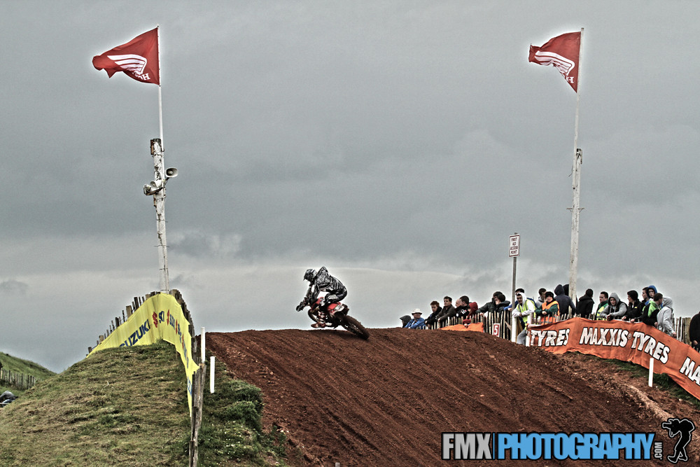 crowd enjoying the riders styling over the honda jump,