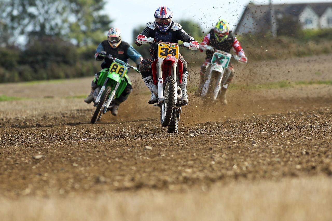 James Sinnott wheelies his way down the straight ahead of his rivals.